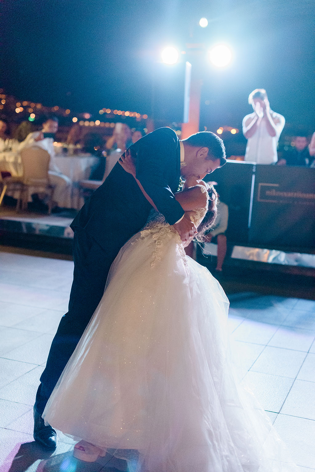 A groom's kiss for the bride during the first dance