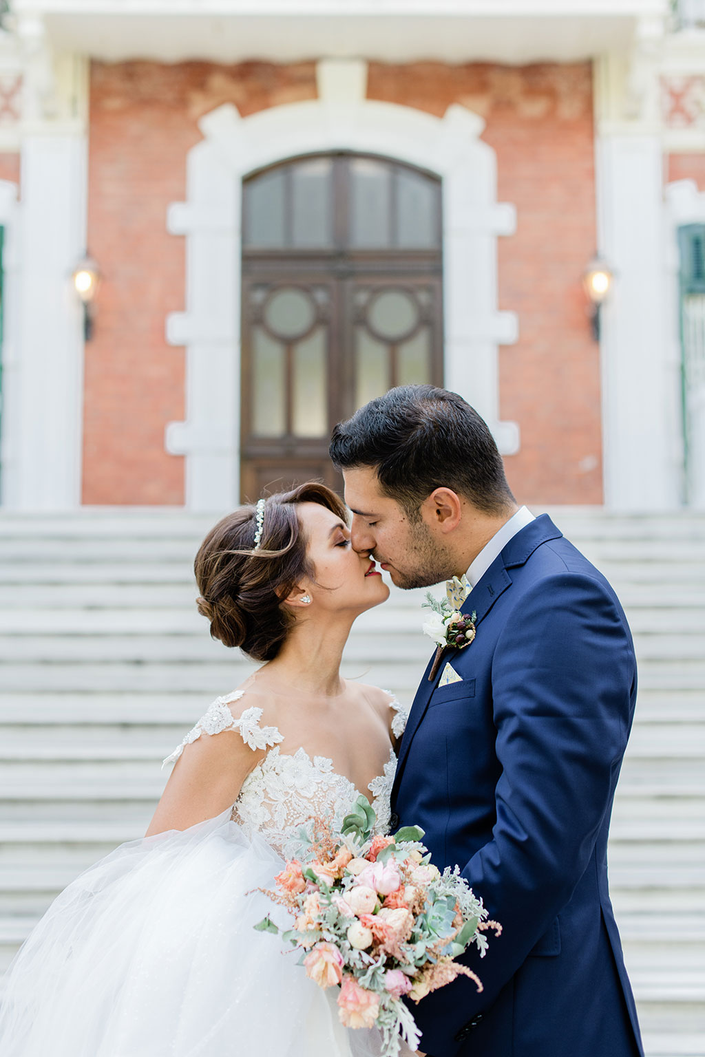 a warm kiss from groom to bride during next day photoshoot in thessaloniki