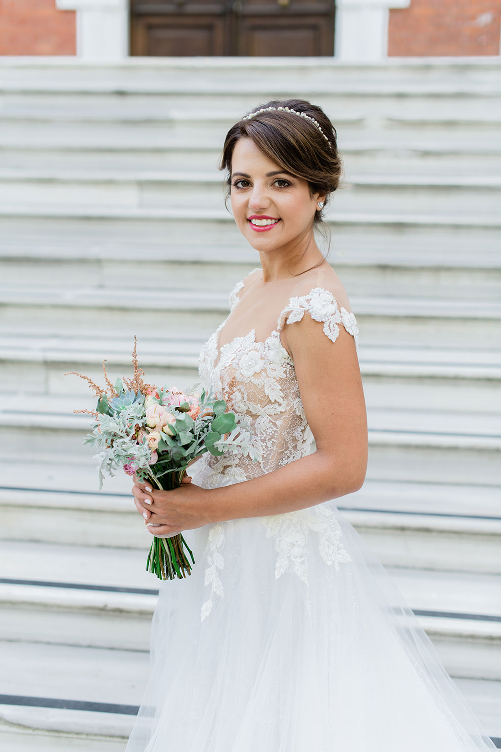 a happy bride with her wedding flowers