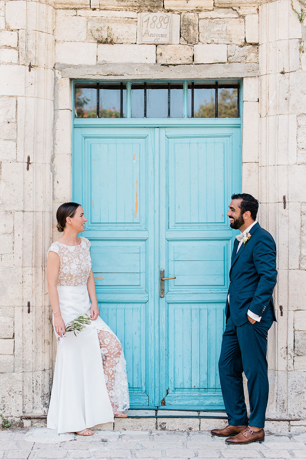 bride and groom in front of the old house door, George Kostopoulos Fine Art Photography