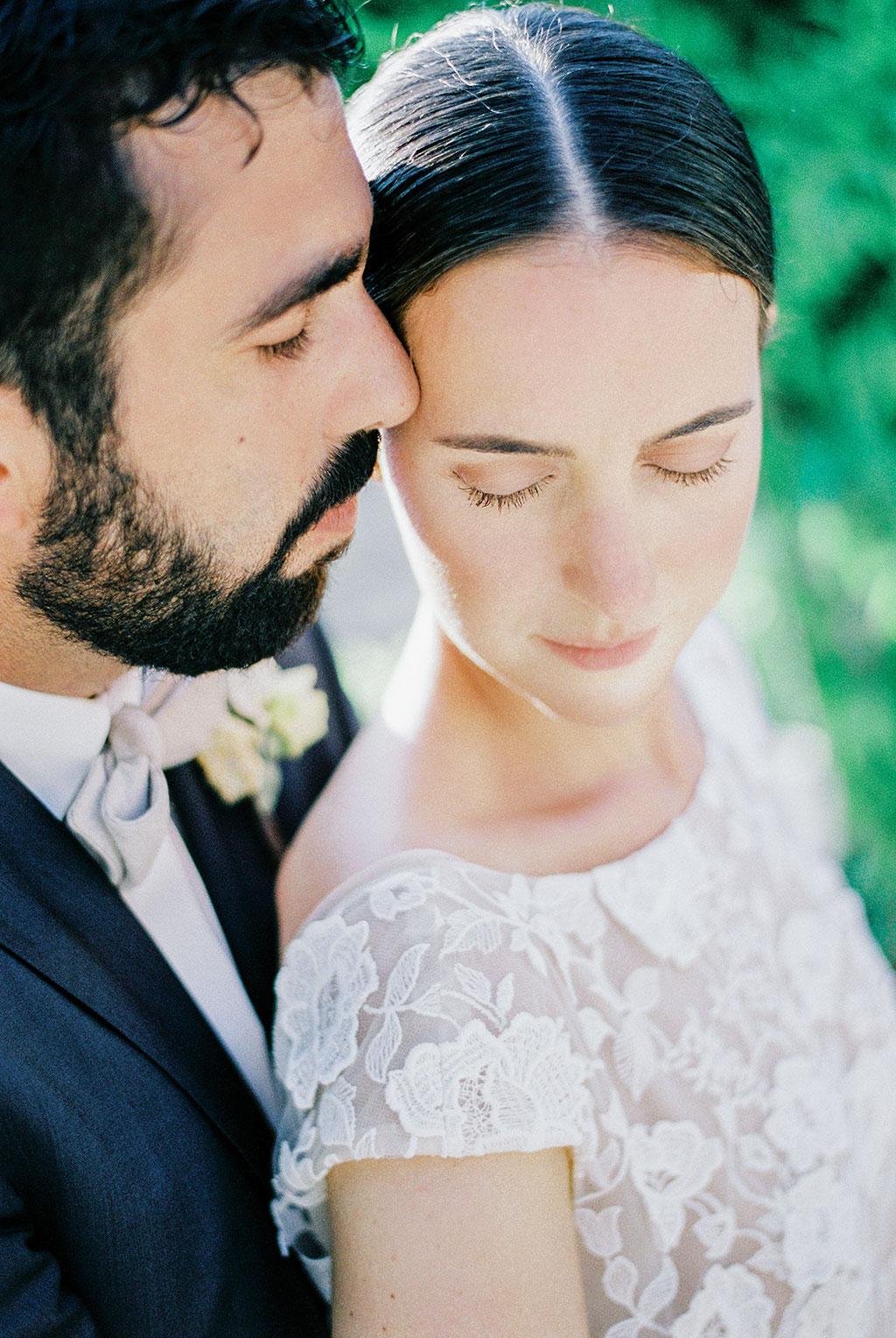 Φωτογραφία γάμου Χαλκιδική, emotional moment between groom and bride on film